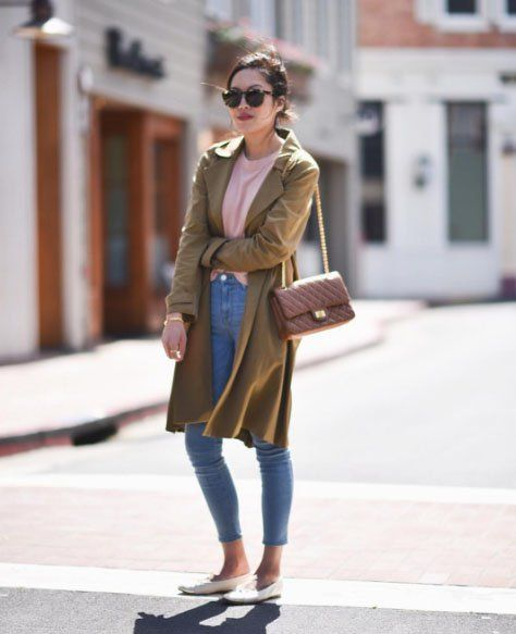 A blush tee with a trench coat, skinny jeans, and flats.
