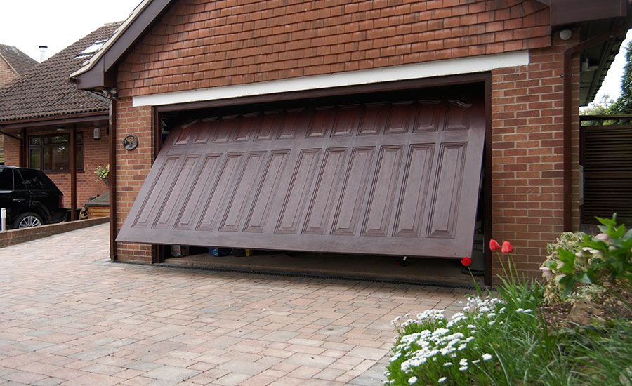 Dark Woodgrain One Piece Grp Garage Door Part Way Open Kerb Appeal