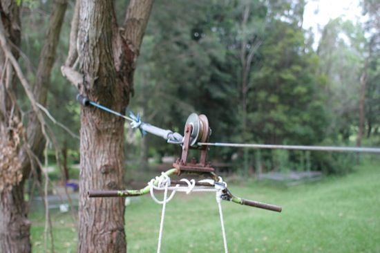 A home made flying fox (zip line), strung between a couple of trees in the backyard, is a simple and fun piece of play equipment that kids will love.