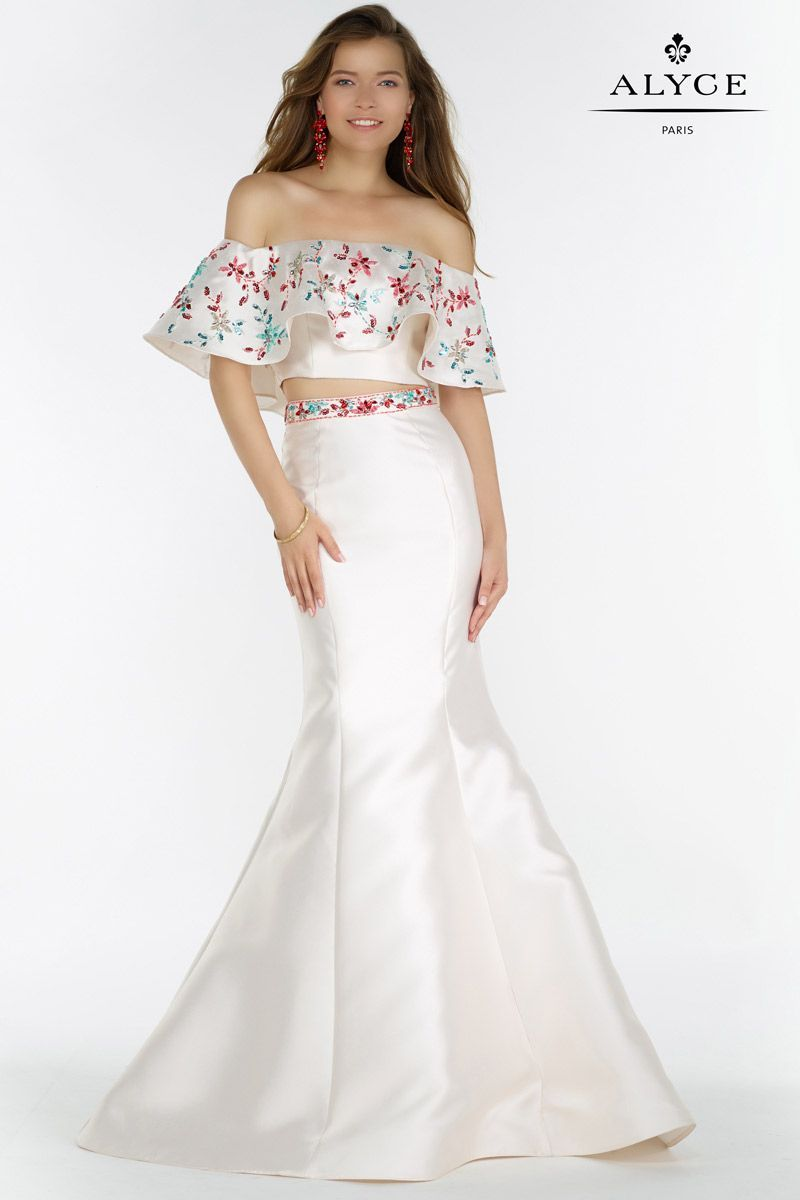 Alyce Paris 6836 is a trumpet mikado gown with an off shoulder ruffled crop top. Embellished at the top and on the skirt waistline.