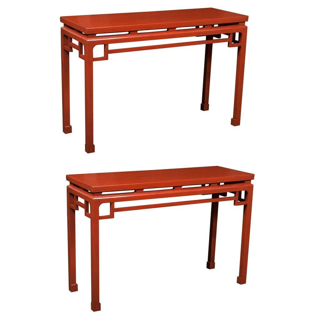 A pair of chinese red lacquered console tables from the s h