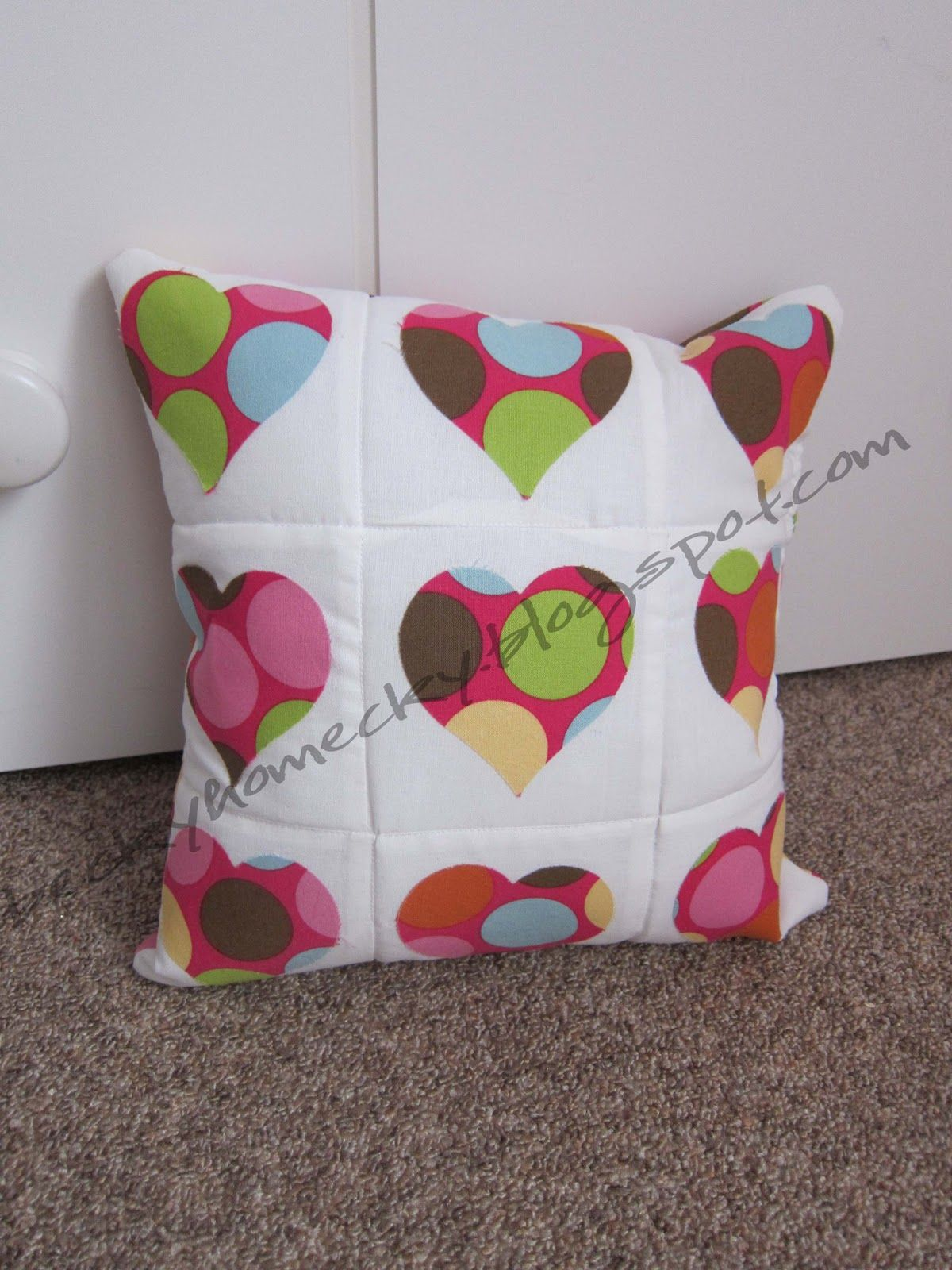 Quick Quilted Pillow! Liking the polka dot hearts! #Sewing