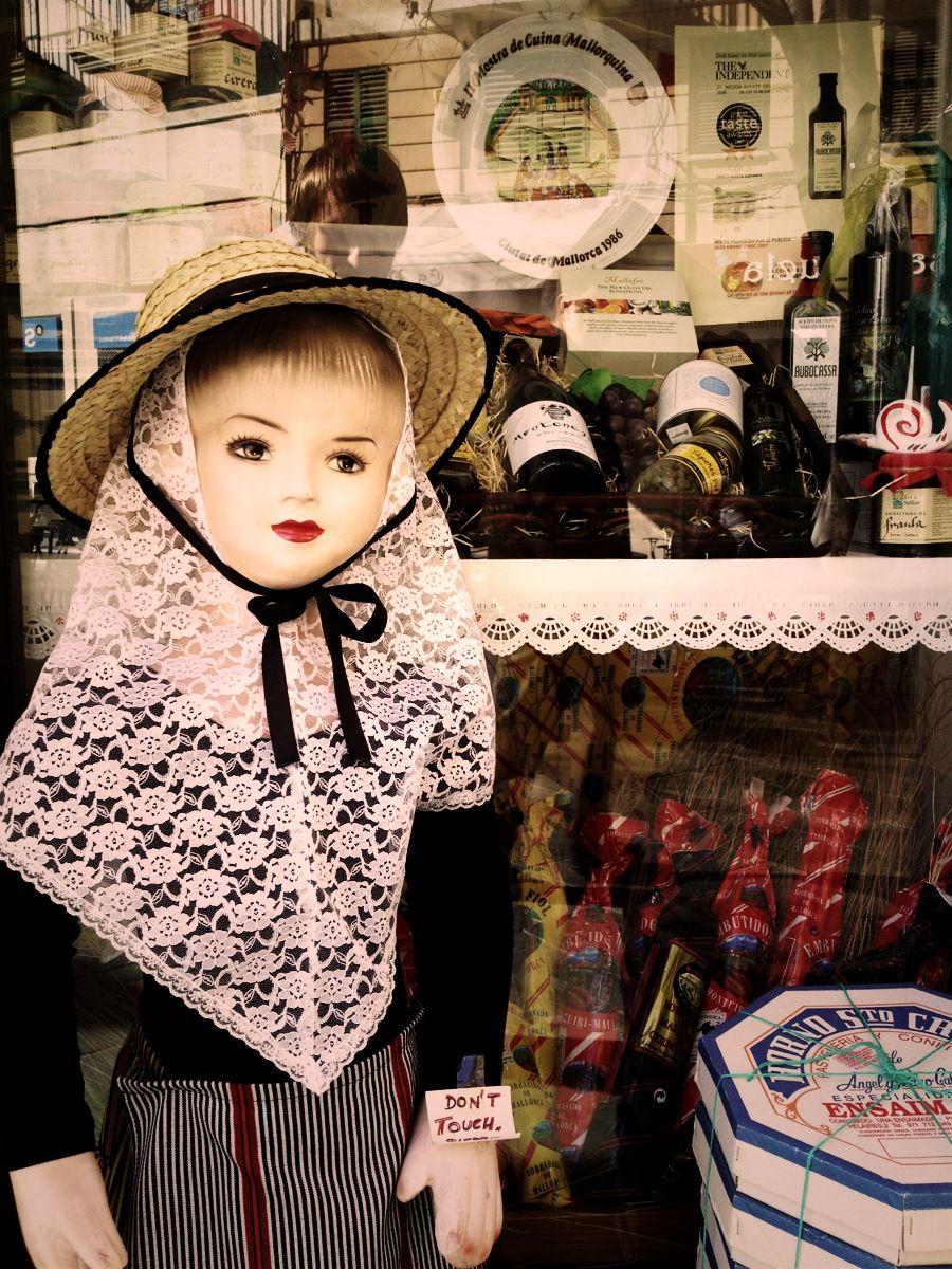 Creepy doll outside a gift shop