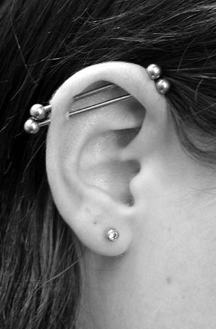 Double Industrial Piercing by *buzz-n-sara on deviantART. @Sharon Macdonald Braun . Woah...This is not what I want for my ear to be different from you. lol