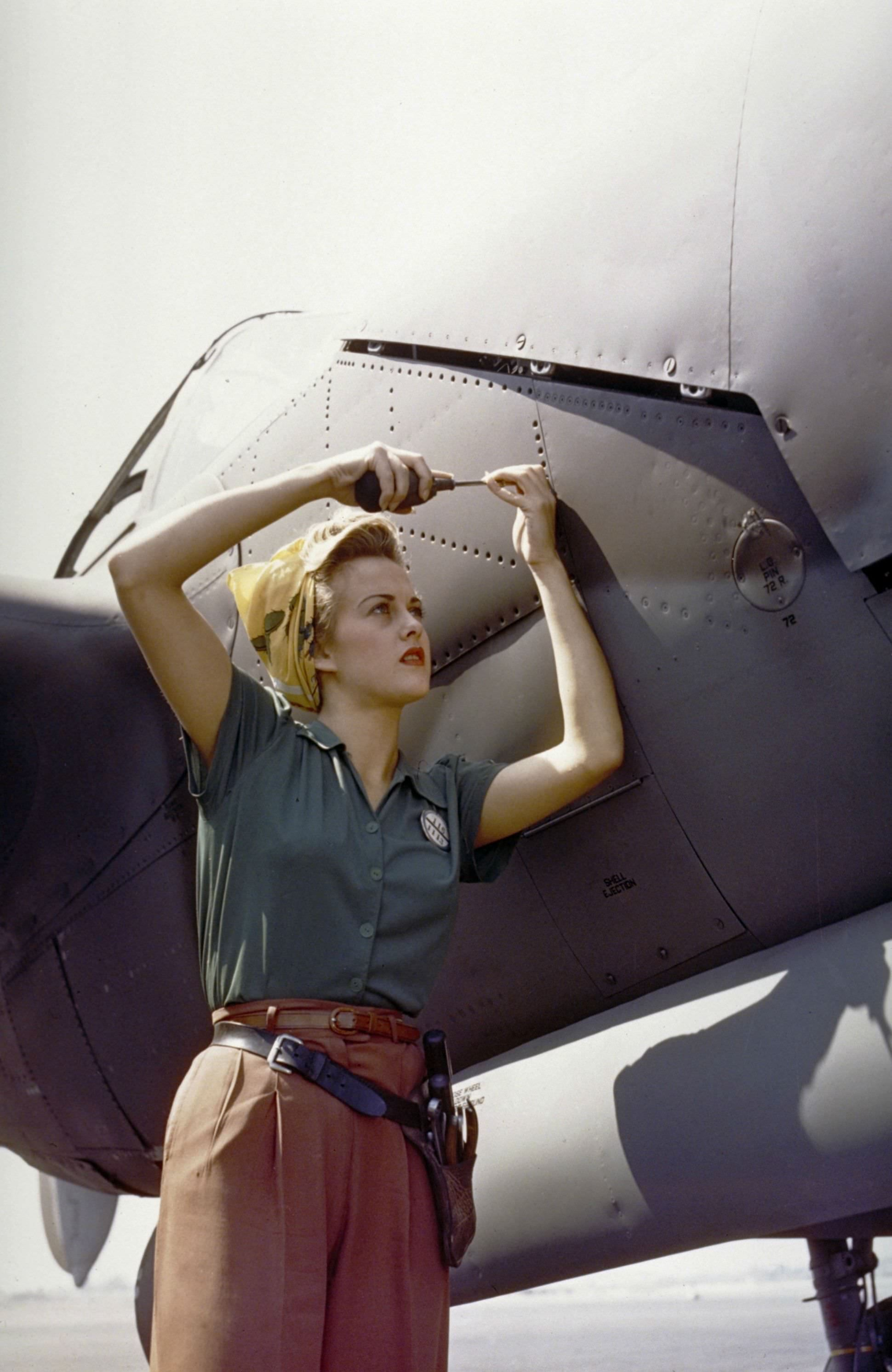 A Lockheed employee works on the fuselage of a P-38 Lightning in California in 1944.