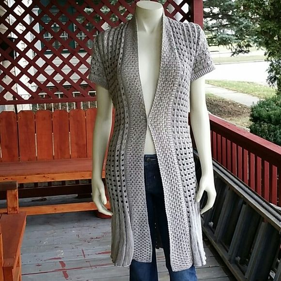 Stunning Cardigan Sweater This sweater has character. Does not close in the front. Pictures really can't capture how nice the o's cardigan really is. Worn only once. Sweaters Cardigans