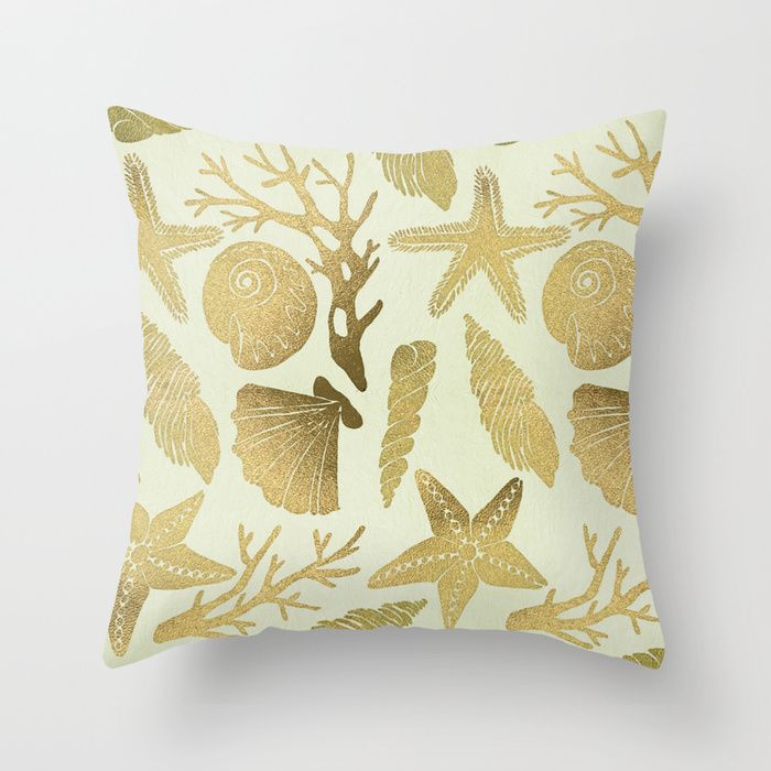 Gold Seashells Throw Pillow by Cat Coquillette