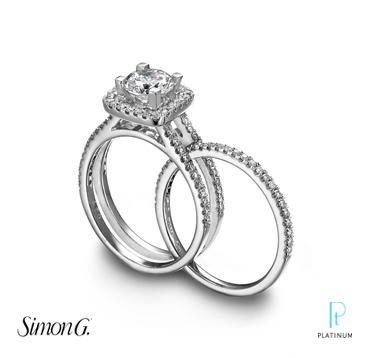 Simon G platinum and diamond engagement ring with matching wedding band.