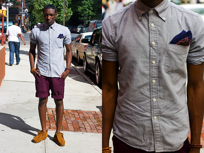Blogger Joshua Kissi of Street Etiquette pairs Clarks Wallabees with shorts.