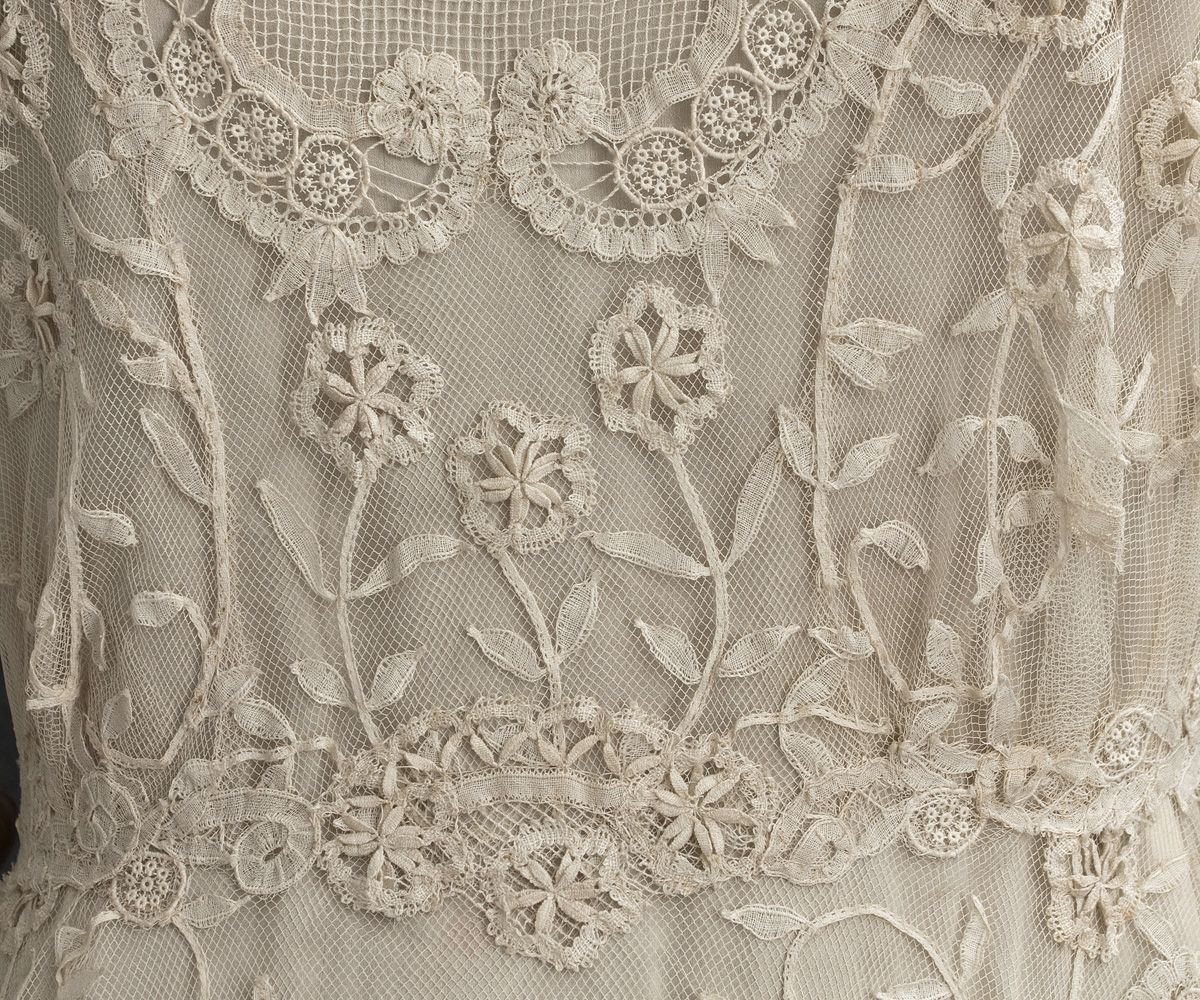 ivory cotton tulle hand-appliquéd with sprays of princess lace flowers & tape lace was used for the fine hand-appliqués