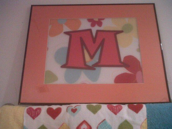 Art work for the girls bathroom.  Dan printed the M for me on some scrap paper we had, the placemat was super cheap at Target and the frame and matt was less than 10 dollars.