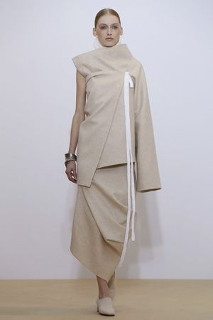 A clean slate. That's what the fall collection of Nehera, a dormant Eastern European brand revived in 2013 and amped up last season with the appointment of Samuel Drira, felt like. There were n...