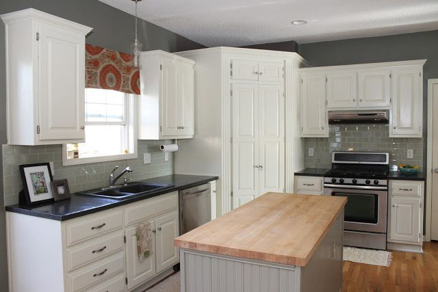 Our 500 diy kitchen remodel white painted cabinets laminate countertops resurfaced with - Diy redo kitchen countertops ...