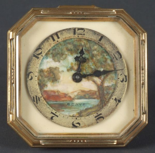 Waltham boudoir clock with German shaped octagonal case and hand painted landscape face, easel back. Marked: (face) Waltham 8 day. (case) Made in Germany.