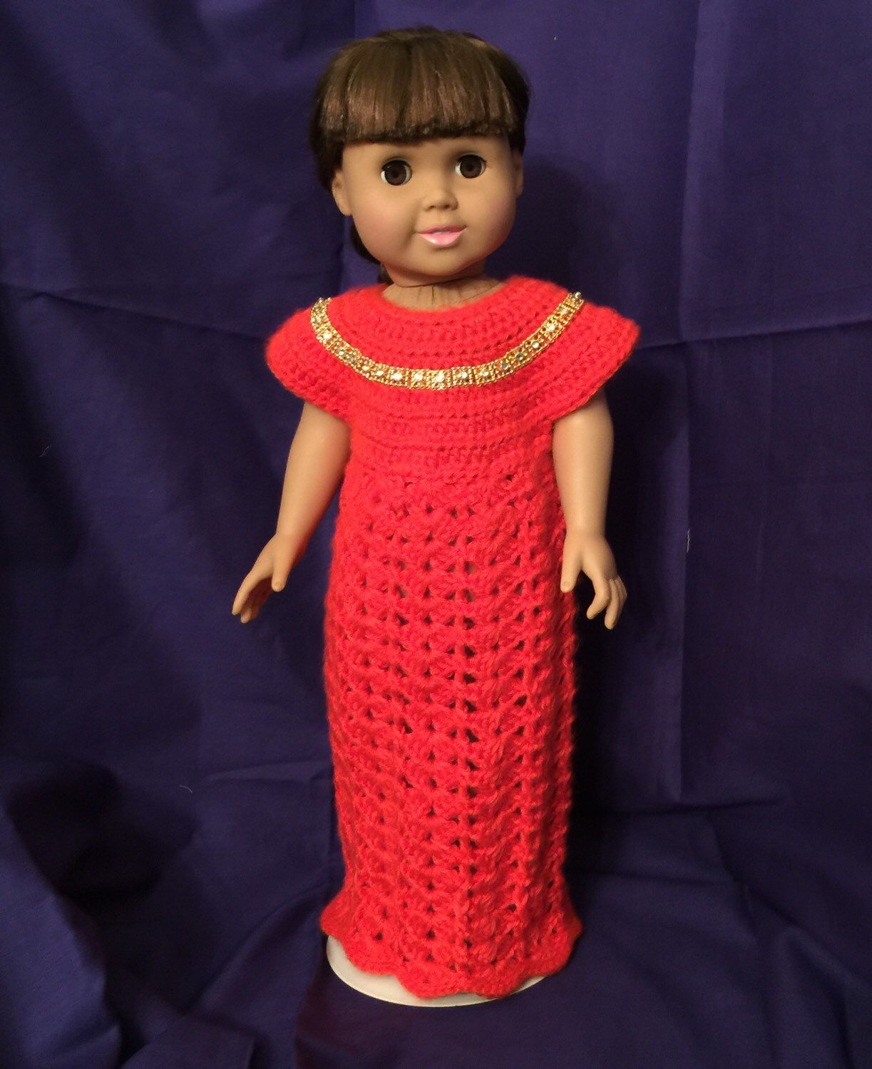 A personal favorite from my Etsy shop https://www.etsy.com/listing/253349259/orange-doll-gown-for-18-dolls