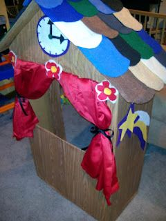 Toddler puppet theater made from a cardboard box, contact paper, felt, and a pillowcase.