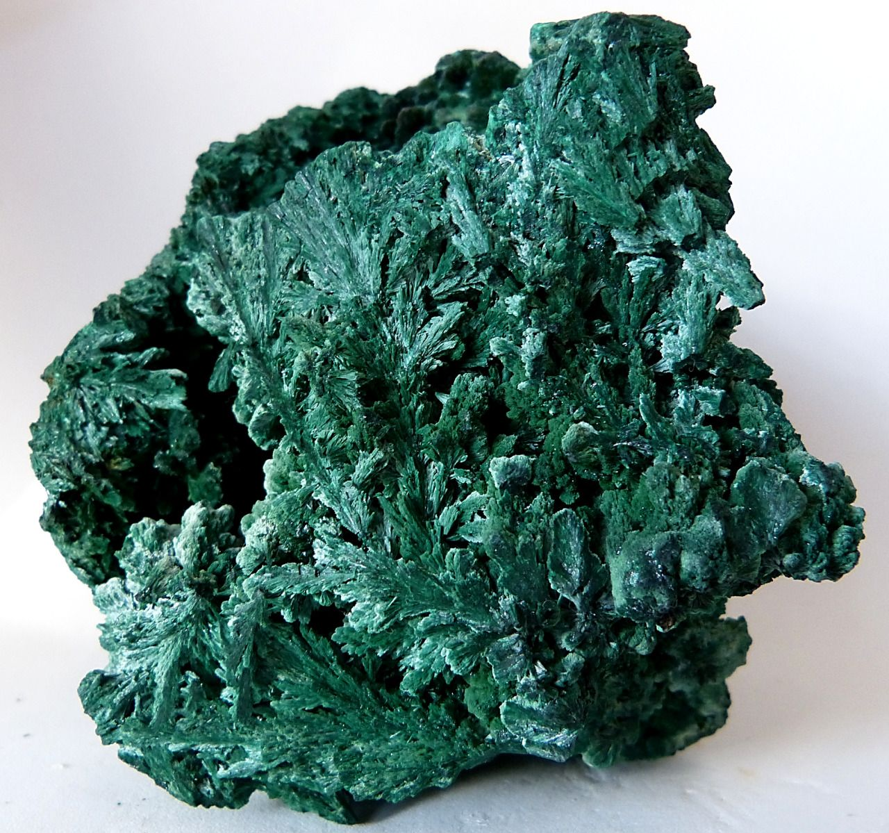 ALACHITE (Hydrated Copper Carbonate) from the Kolweizi Mine, Shaba, Congo. Solid, fibrous textured malachite measuring 11 centimeters across.