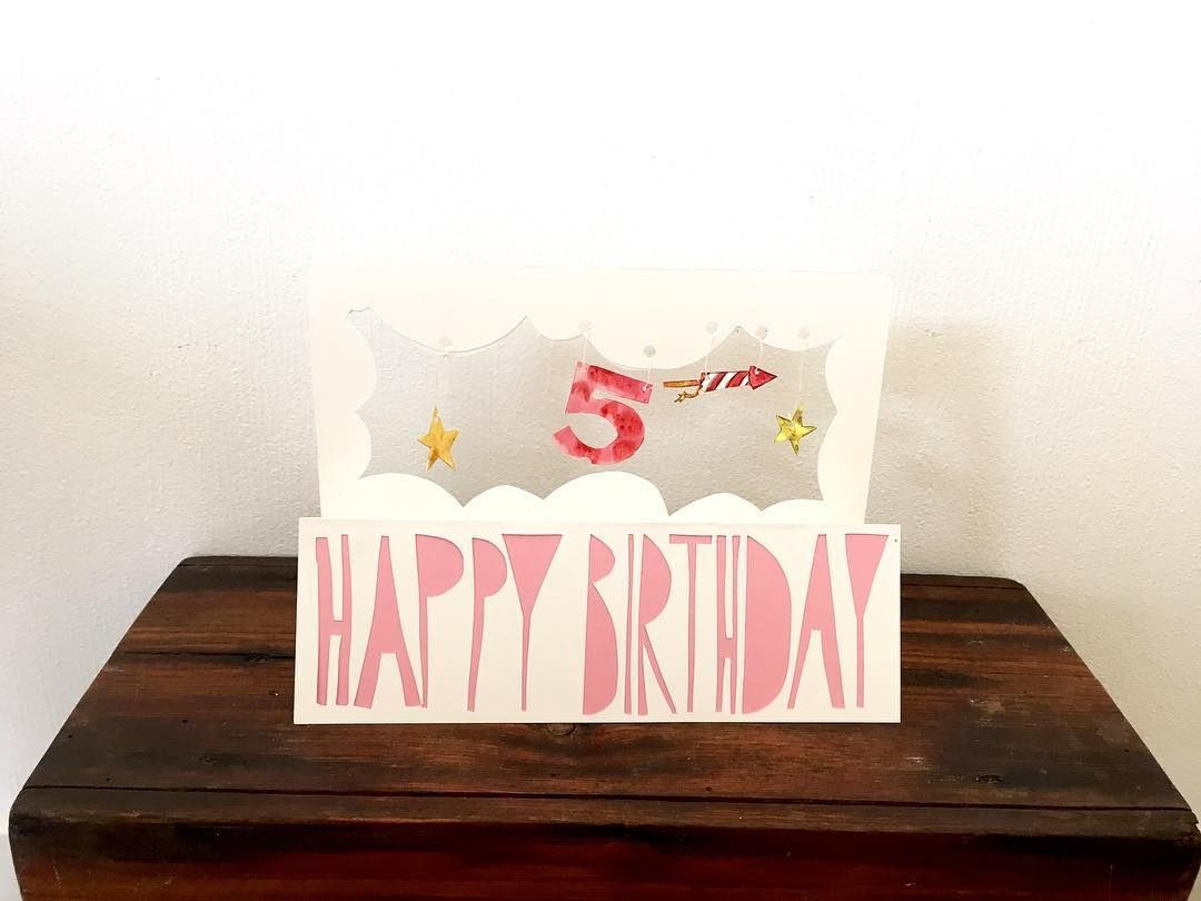 Happy birthday card with a dangling and stars the writing is a