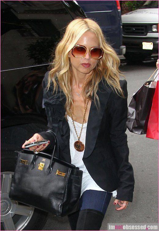 Charlize Theron: Sunglasses – Karen Walker Purse ...