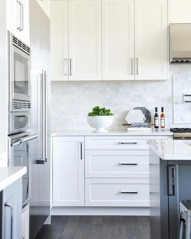 white shaker panel cabinets + dark grey island + marble backsplash #whitekitchen #whiteshakercabinets