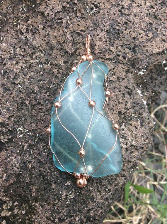 Photo of Free US shipping Hawaiian sea glass pendant, fish net wrapped sea glass, wire wrapped copper, caged sea glass, hawaiian jewelry, copper sea