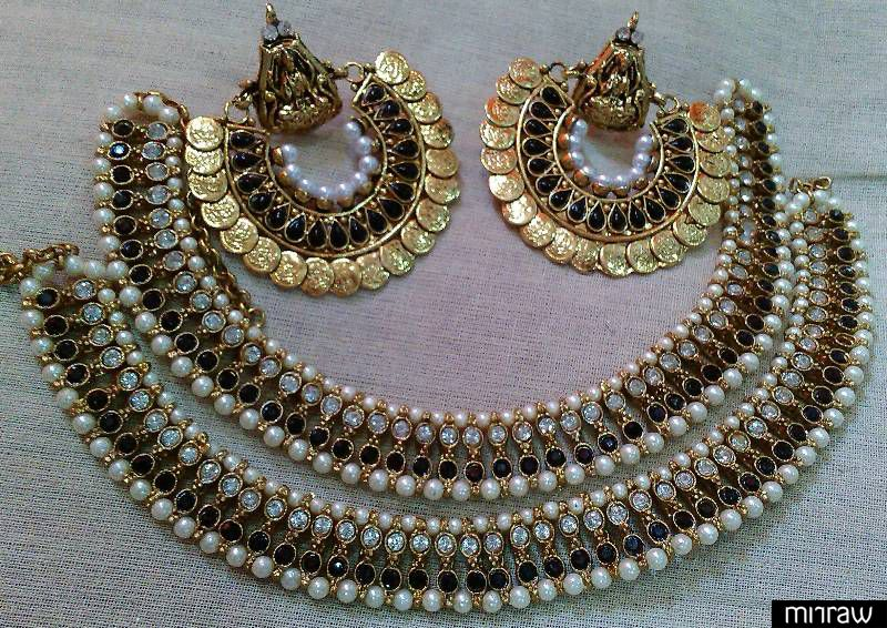 Designer Ram Leela Earings with Copper Anklets suits perfect with your traditional wear.