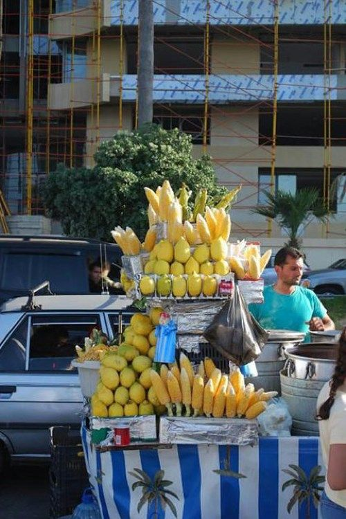 BEIRUT, LEBANON: A vendor selling sweetcorn and lemons on the Corniche