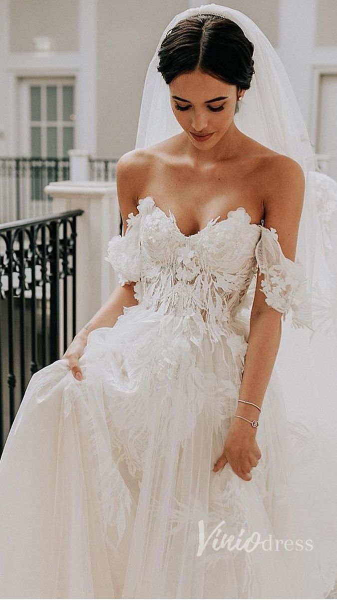 Off the shoulder champagne wedding dress with train. #romanticlace