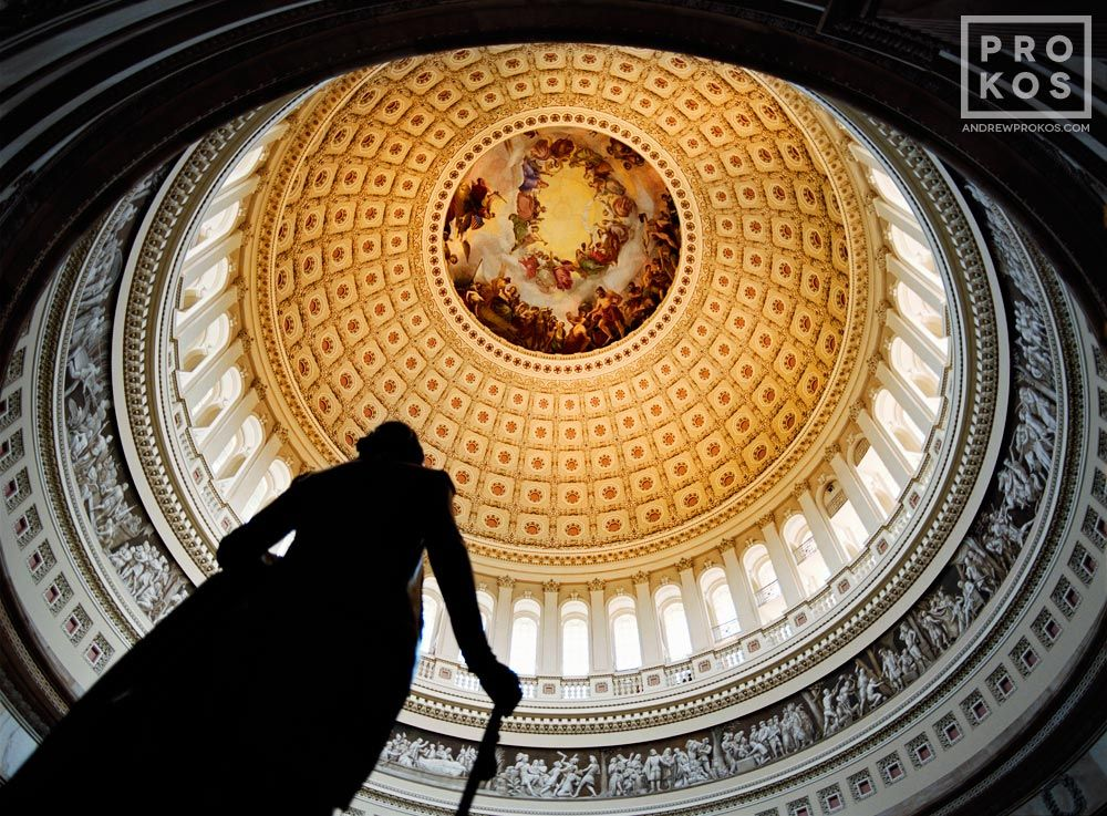 The rotunda of the U.S. Capitol building with statue of George Washington, Washington D.C. - Purchase a framed print of this photo or license the high-resolution image.