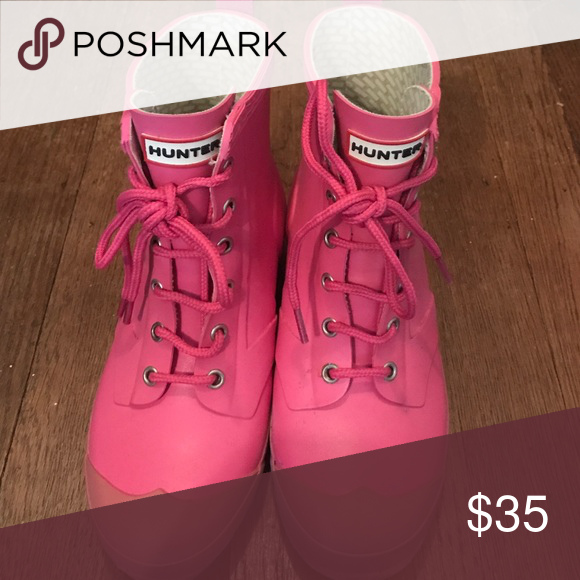 Pink Hunter rain boots Size 4 Great condition, gently worn rain boots. I'm a 5 and they fit me but the size says 4 Hunter Boots Shoes Winter & Rain Boots