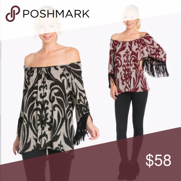 Black Off-the-Shoulder Top with Fringe BLACK and grey, off-the-shoulder top with brocade pattern and black fringe trim on sleeves. Quarter sleeve length. Fringes have Faux suede feel. Made in the USA. 95% polyester, 5% Spandex. Auditions Tops