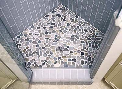 Using Tile in the Bathroom   bathroom   Pinterest   River rock floor     i LOVE river rock floors  i tried in vain to convince my husband to do  this  even as a bathmat  i don t love them with this particular wall tile
