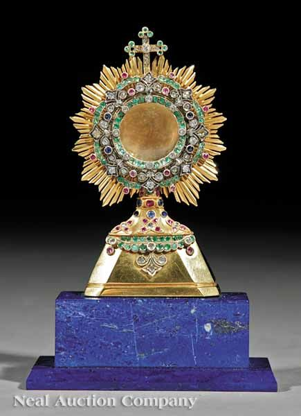 Russian Orthodox Silver, Gold and Gemstone Monstrance, marks rubbed, possibly Dmitri Andreev, active St. Petersburg, 1835-1860, sunburst frame set with old mine cut sapphires, diamonds, emeralds and rubies, later lapis lazuli base