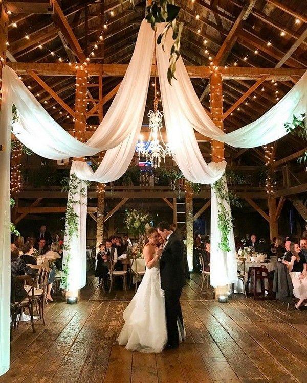 barn wedding reception ideas with draping fabric and lighting   - Wedding Decoration Ideas -