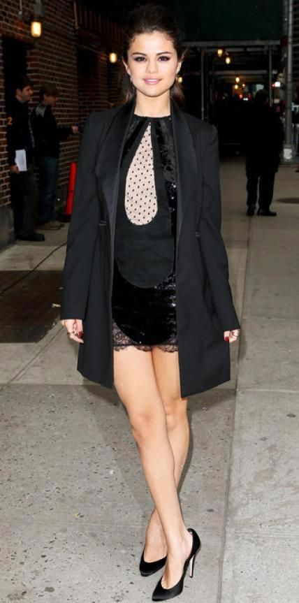 Look of the Day › March 19, 2013 WHAT SHE WORE Selena Gomez stopped by The Late Show with David Letterman in a sequined Emilio Pucci dress, Dolce & Gabbana blazer and Brian Atwood shoes. WHY WE LOVE IT The actress's high ponytail and layered gold rings gave the sophisticated look a touch of edge. #BrianAtwood
