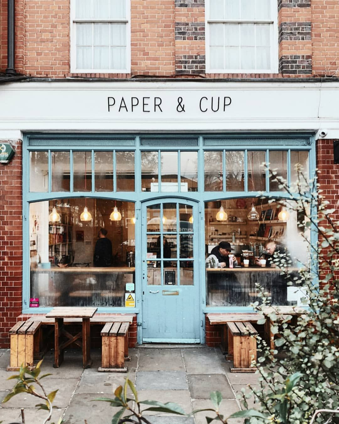 Cute Brick Exterior With Pale Turquoise Door And Windows Storefront Design Cafe Exterior Coffee Shop Aesthetic