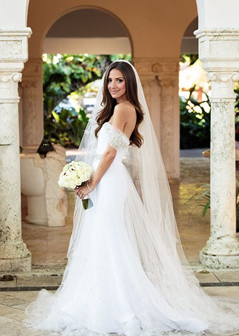 Uniquely glamorous tulle off-the-shoulder wedding dress; Featured Photographer: Fred Marcus Studio