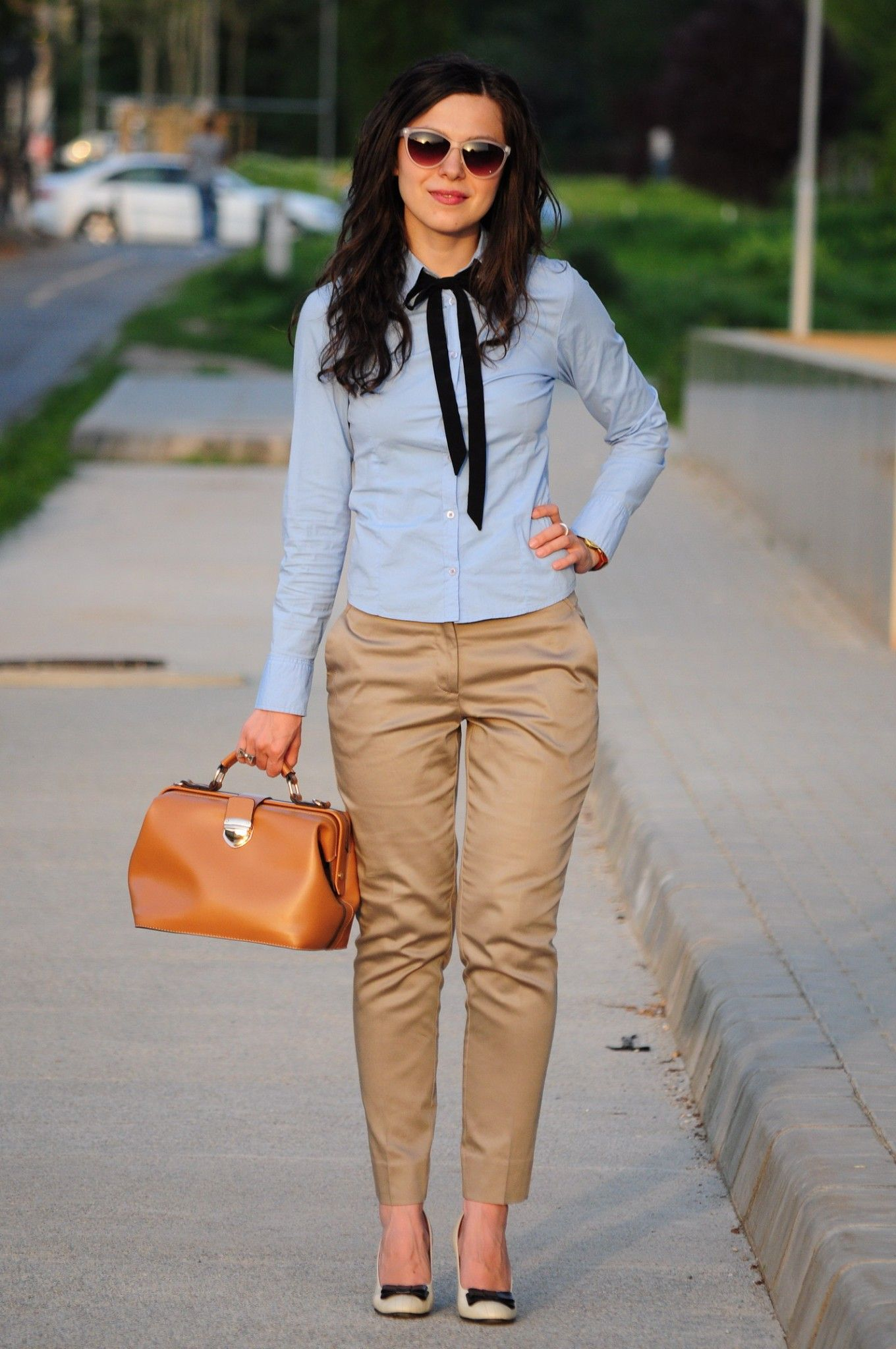 nude pants and blue shirt