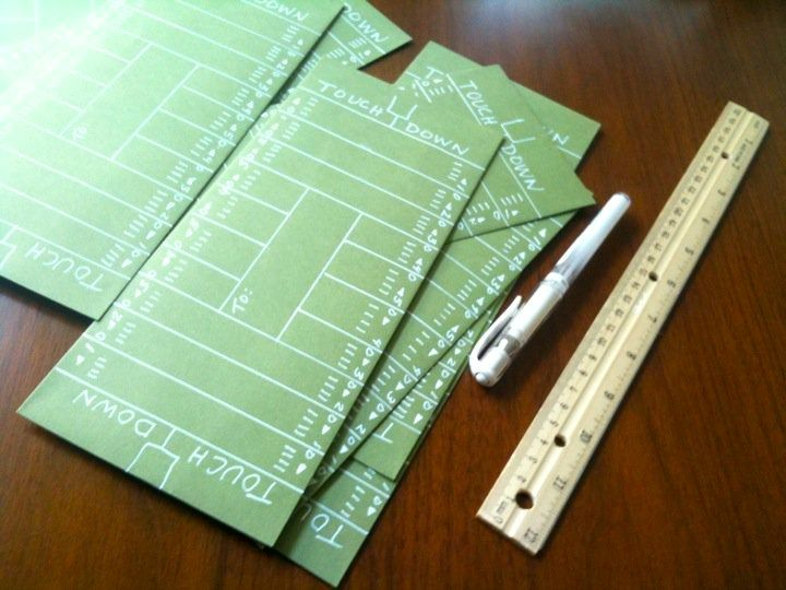 Envelopes for the football invites made with white pen – Party Invitation Envelopes