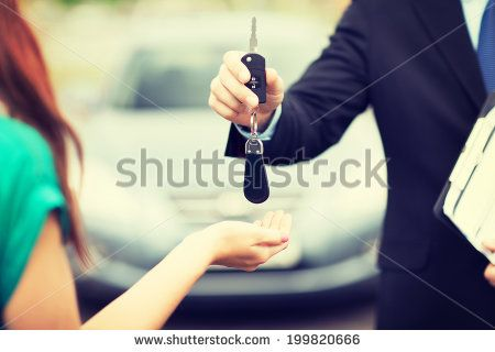 transportation and ownership concept - customer and salesman with car key outside - stock photo