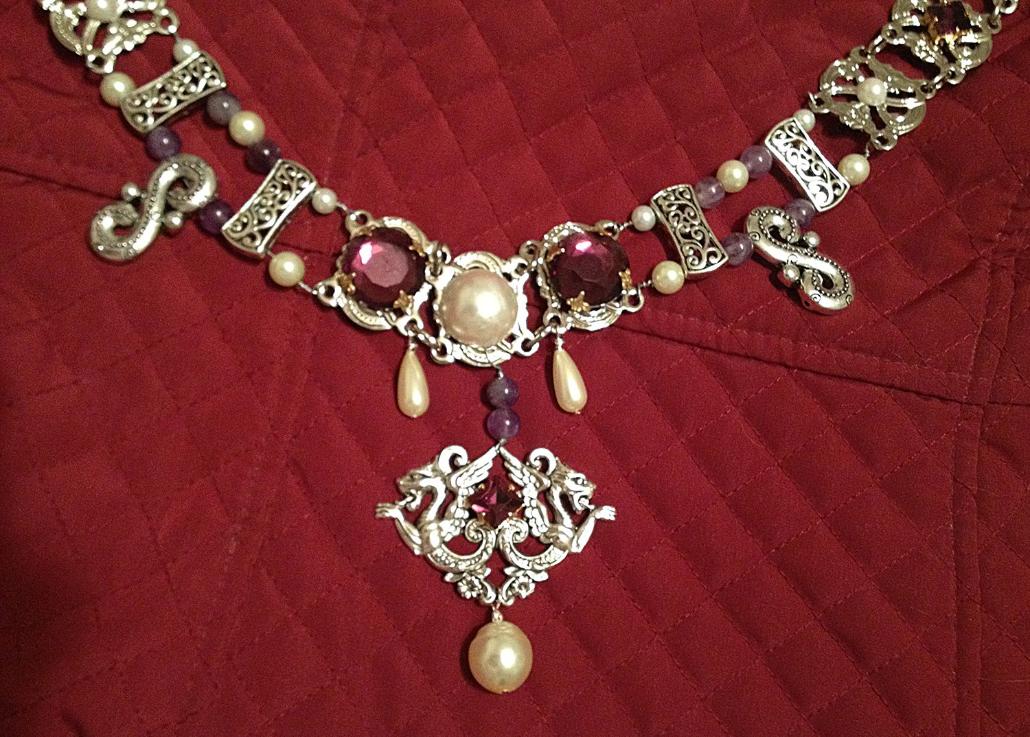 Renaissance Chain of office or livery collar by Karen Troeh with glass pearls, genuine amythest beads, purple rhinestones, filigree, scrollwork and dragons. This was a custom piece. Contact me at my Etsy shop for more chains of office or to order a unique one for yourself!