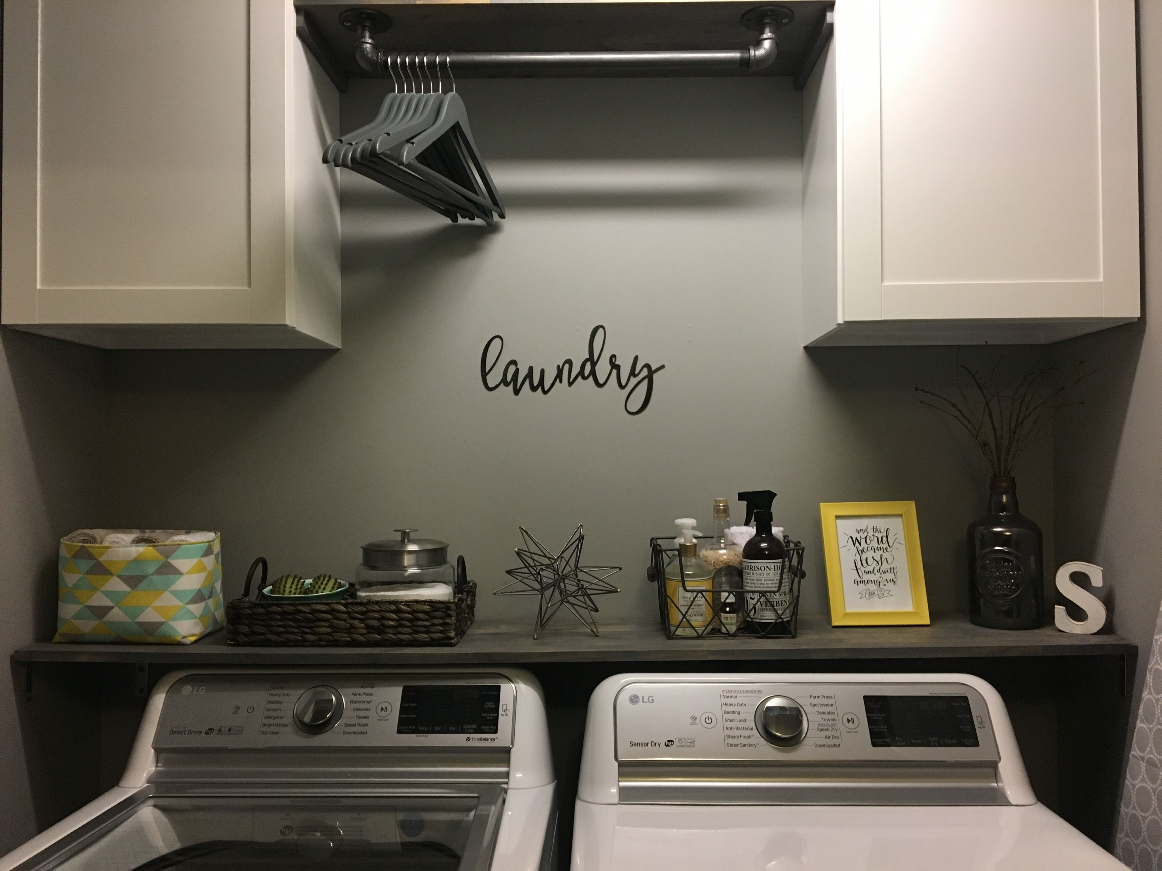 Laundry Room Renovation Shelf With An Industrial Pipe To Hang