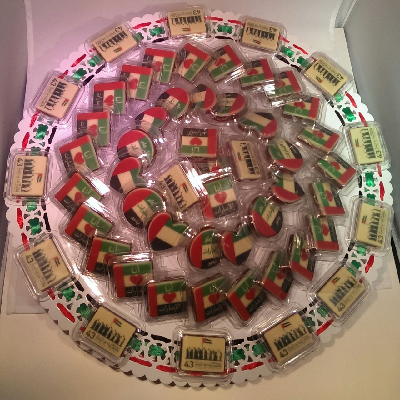 A Tray Of Chocolates Printed With Different Designs For Uae National Day On 2nd December Uae Chocolate Uaeflag Uaefood Bombones