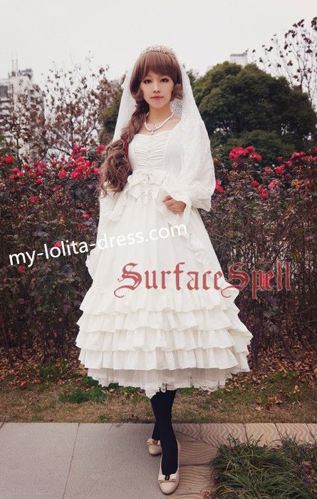 This is new style from surface spell, white gothic lolita one piece dress featuring puffy sleeves, bows and long skirt. It's gorgeous and will make best of your bodyline.