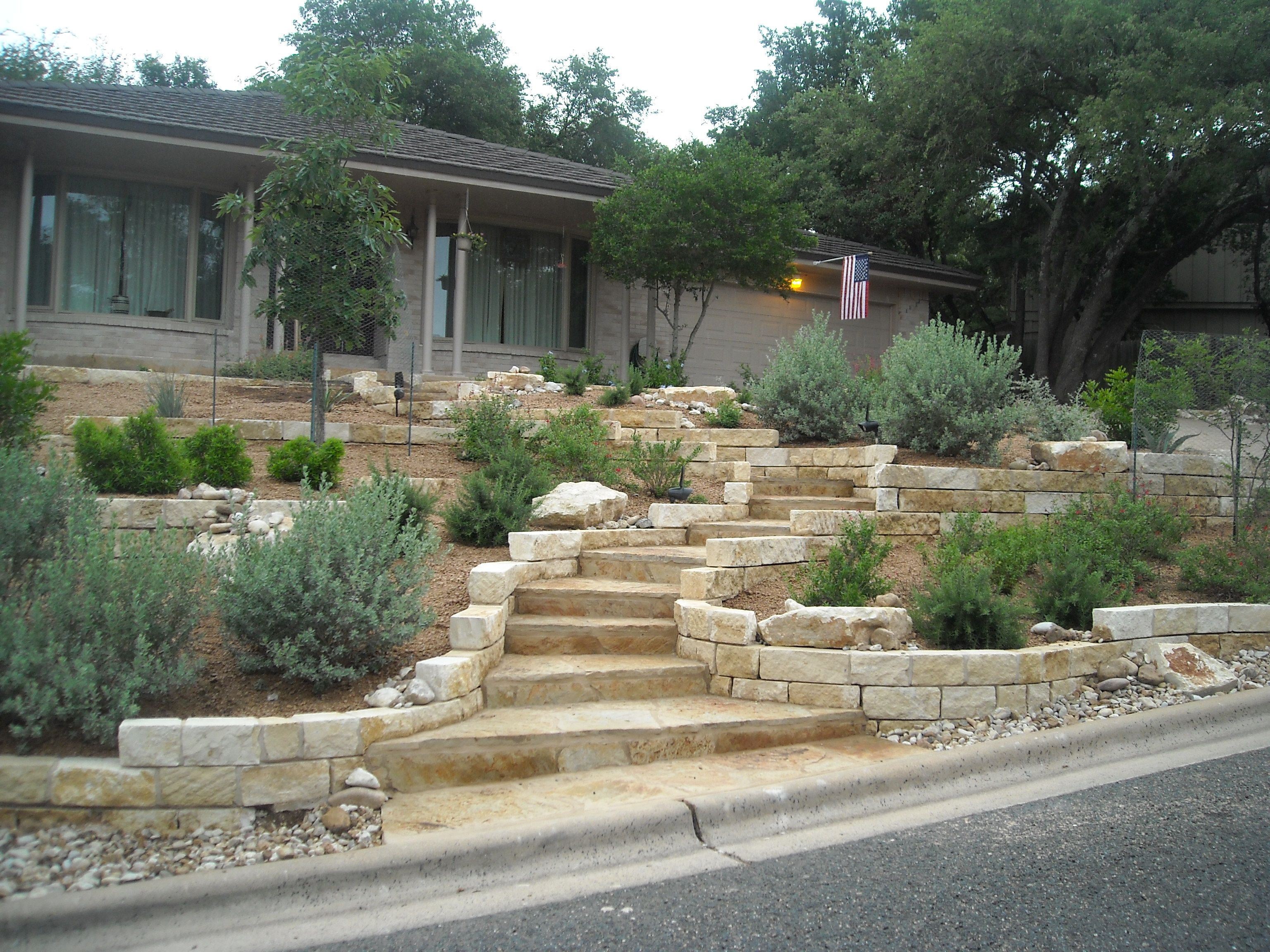 Backyard patio ideas flagstone - Xeriscape Front Yard With Limestone Retaining Walls And A