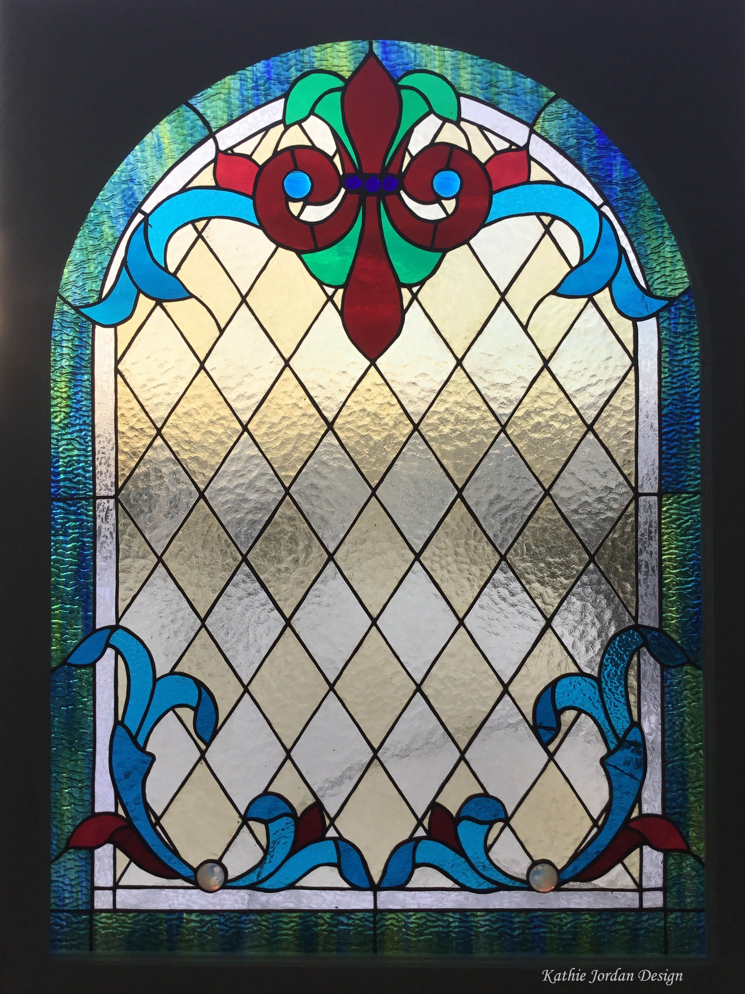 Custom stained glass window made by Kathie Jordan Design for a stairway window in Kitchener ON, Canada #stainedglass #glass #archtop #arch #top #curvedwindow #tiffanywindow #kwawesome #gridwork #fleurdelis