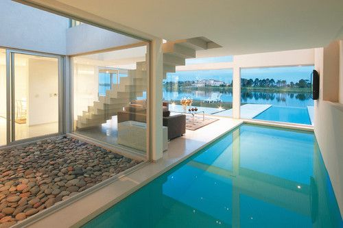 Dream House With Indoor Pool step — or swim — inside a dream house with indoor-outdoor pools