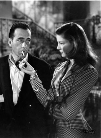 """Humphrey Bogart and Lauren Bacall in Howard Hawks' To Have and Have Not"""" (1944). Hawks' wife Slim (later Slim Keith) discovered Bacall on the cover of Harper's Bazaar, having no idea that she had attended the prestigious American Academy of Dramatic Arts."""