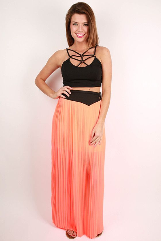 This pretty maxi skirt is the perfect way to brighten up your spring wardrobe! We love the pleats and vibrant color that will cause heads to turn wherever you go! Pair it with wedges and one of our amazing blouses, then make a statement in this one! Features a zipper closure on the side and partial lining.