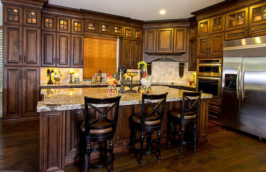 This kitchen features the Anderson door style in a dark ...